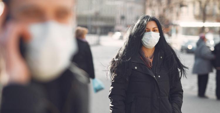 people in the street wearing masks
