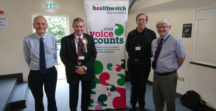 Picture of four men at a healthwatch event