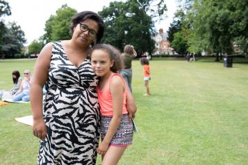 Mother and daughter smiling at the camera at Healthwatch event