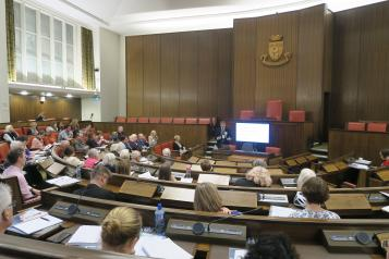 Chris Bain speaking to people in the Warwick council chamber