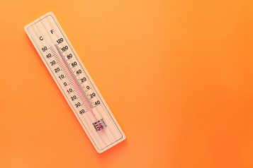 a thermometer showing a high reading