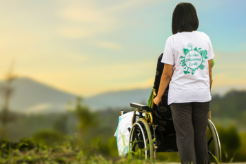 lady with a wheelchair user, outside