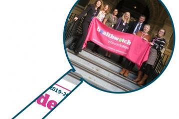 Staff team with Healthwatch Warwickshire banner