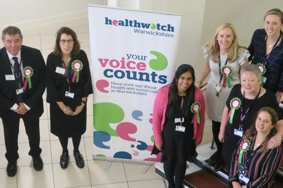 Healthwatch staff members with a banner