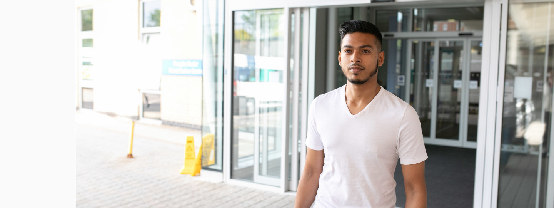 A young man outside a hospital